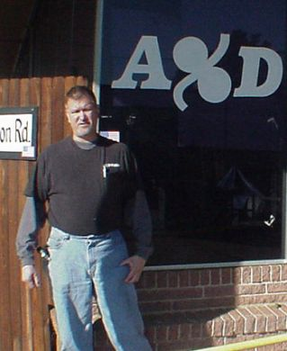 Allen Campbell in front of his Texarkana, TX storefront